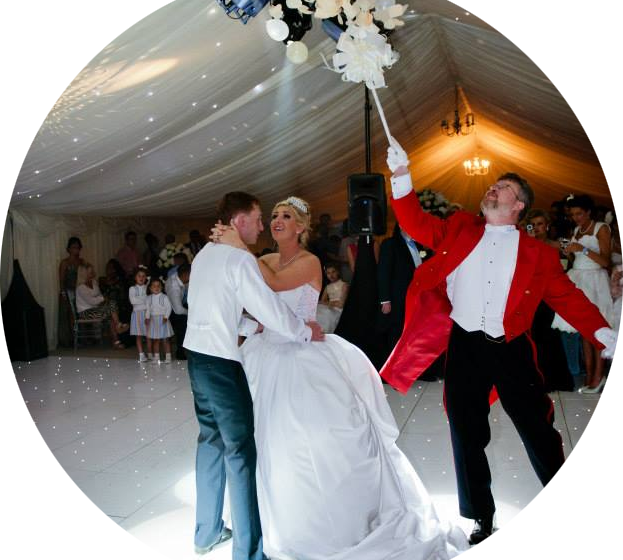 Toastmaster popping a balloon during the first dance