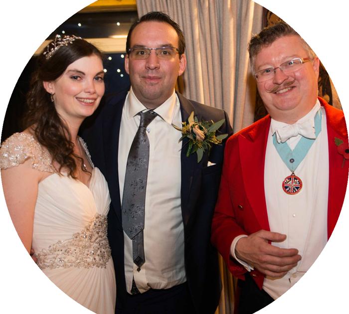 Toastmaster with wedding couple